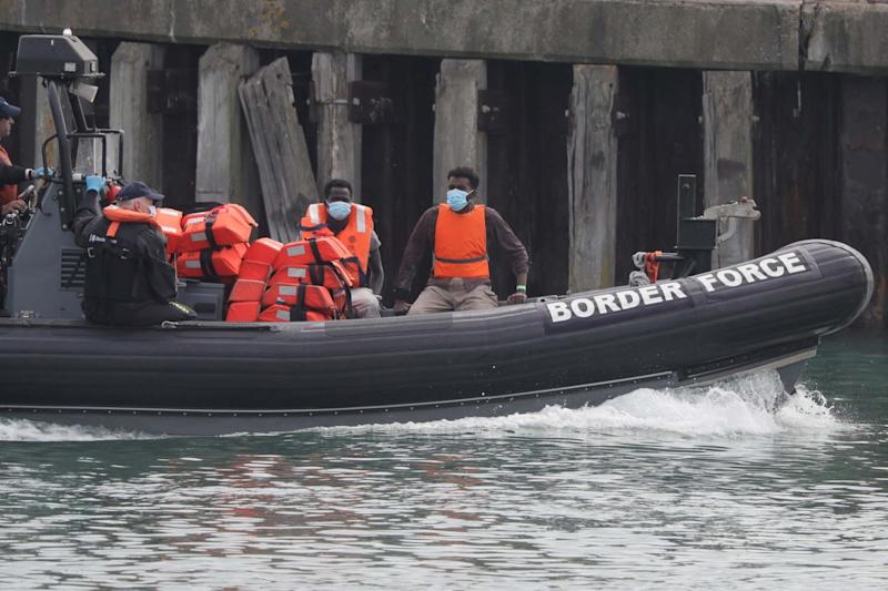 A Border Force vessel brings a group of people thought to be migrants into the port city of Dover: AP