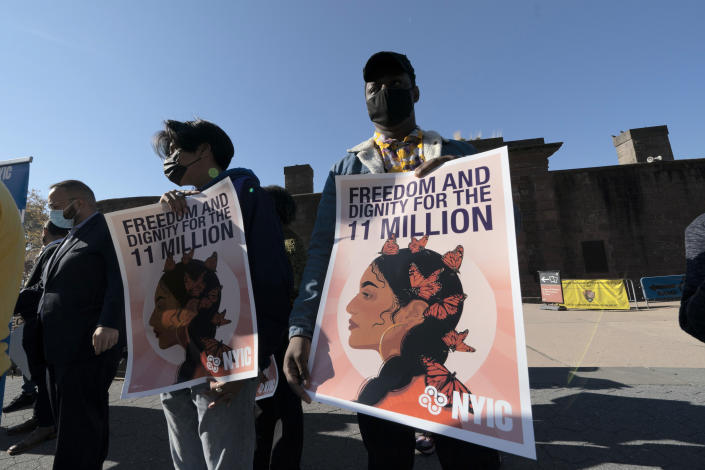 Isaiah Buffong holds a sign at a rally, Monday, Nov. 9, 2020, in New York. Those at the rally are asking President-elect Joe Biden to prioritize immigration reform. (Mark Lennihan/AP)