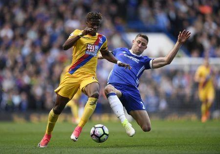 Britain Soccer Football - Chelsea v Crystal Palace - Premier League - Stamford Bridge - 1/4/17 Crystal Palace's Wilfried Zaha in action with Chelsea's Gary Cahill  Action Images via Reuters / Tony O'Brien Livepic