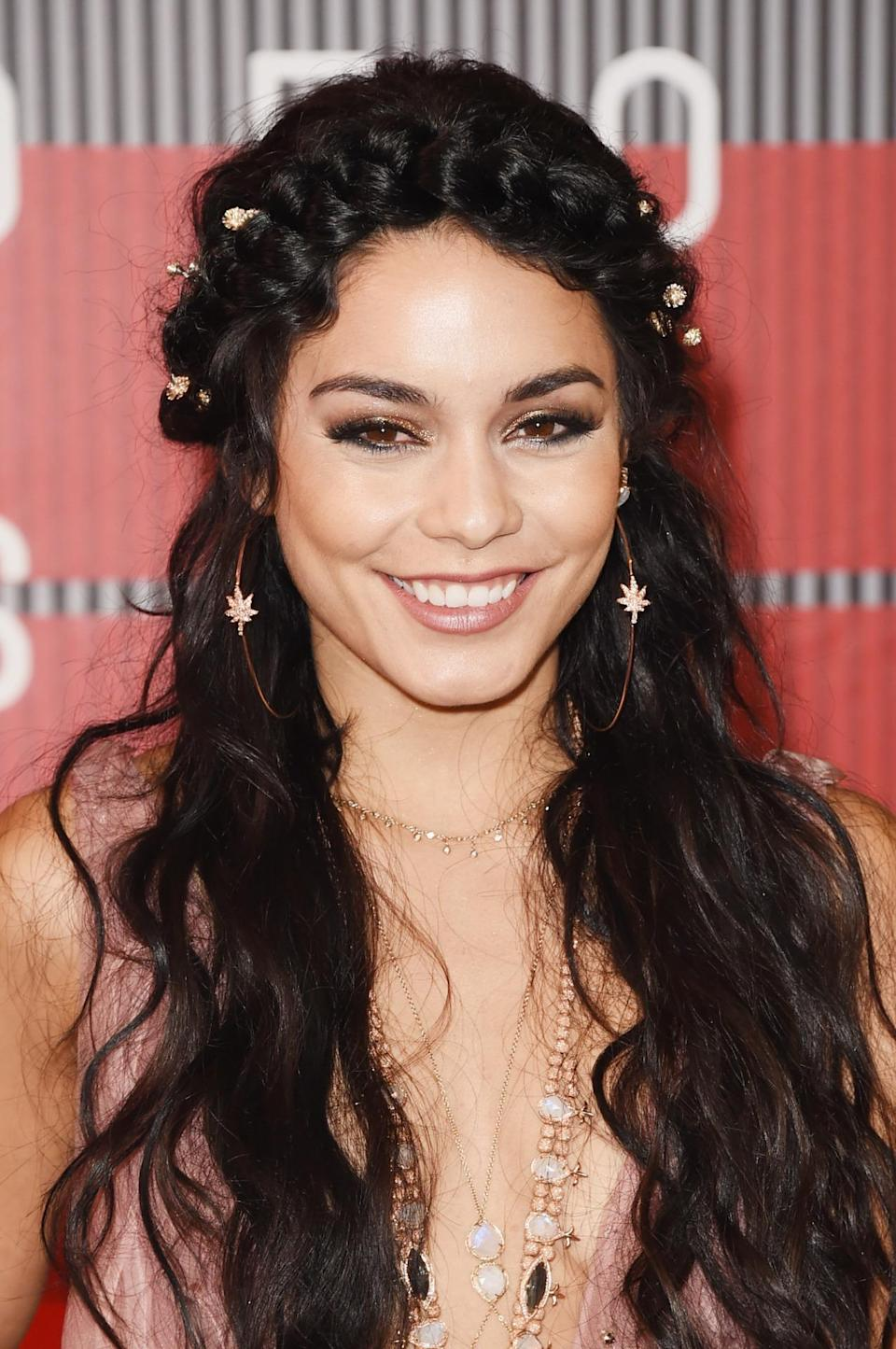 <p>With a crown braid and cascading jeweled flowers in her hair, this look seems better suited for Coachella or a walk down the aisle than the VMAs. </p><p>Source: Getty Images<br></p>