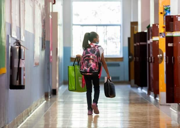 Schools in areas with higher COVID-19 rates and lower vaccination rates are receiving rapid tests to be used on symptomatic students. (Graham Hughes/The Canadian Press - image credit)