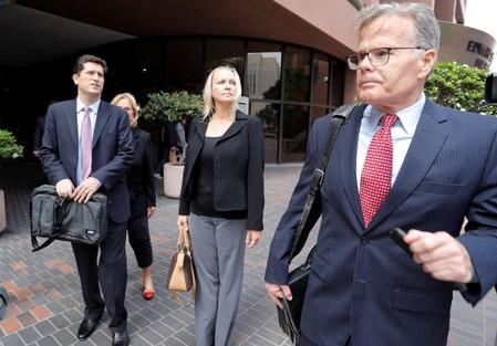 U.S. Rep. Duncan Hunter's wife Margaret Hunter leaves the federal court with her attorney, Thomas McNamara in San Diego