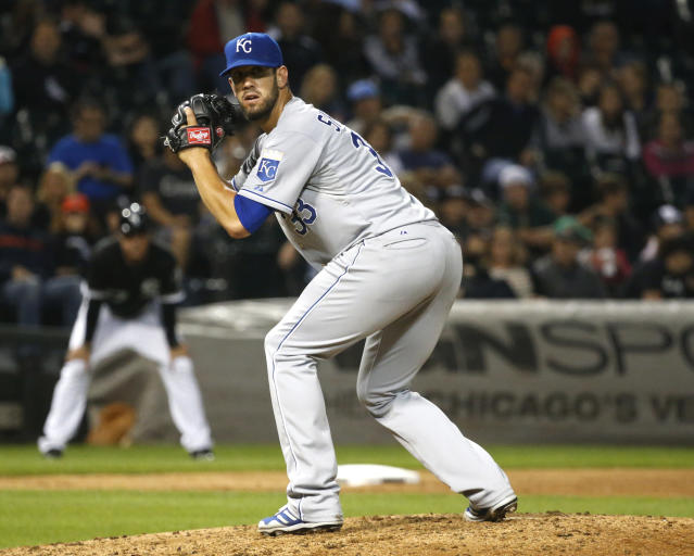 Kansas City Royals starting pitcher James Shields checks Chicago White Sox baserunner Alejandro De Aza at first during the fifth inning of a baseball game on Friday, July 26, 2013, in Chicago. (AP Photo/Charles Rex Arbogast)