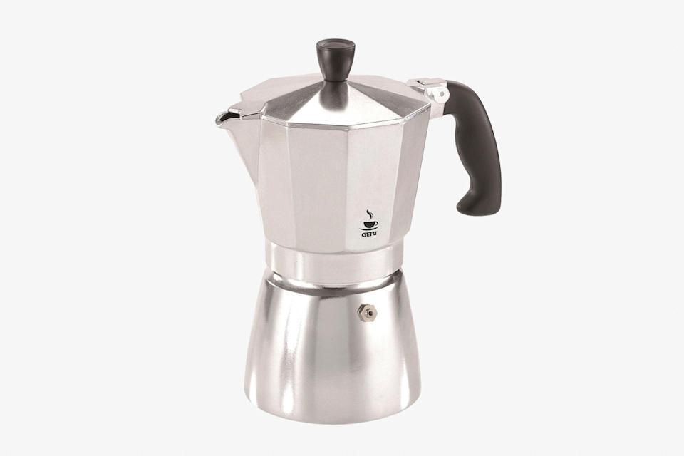 """When it comes to Italian-style coffee, the stovetop Moka pot is hard to beat: It's been a staple in <a href=""""https://www.cntraveler.com/story/italian-cooking-ingredients-cookbooks-cookware?mbid=synd_yahoo_rss"""" rel=""""nofollow noopener"""" target=""""_blank"""" data-ylk=""""slk:kitchens throughout Italy"""" class=""""link rapid-noclick-resp"""">kitchens throughout Italy</a> and beyond since its invention in 1933. This small aluminum wonder is a beloved classic for its ultra-strong, espresso-like coffee and its low-tech engineering. Water is placed in the bottom chamber and as it boils, steam forces the hot water up through the coffee filter fitted in the middle of the device. Brewed coffee collects in the carafe on top. The metal pot looks great on a countertop and travels well, too. In fact, author Namwali Serpell <a href=""""https://www.cntraveler.com/story/author-namwali-serpell-gets-her-best-ideas-on-planes-and-trains?mbid=synd_yahoo_rss"""" rel=""""nofollow noopener"""" target=""""_blank"""" data-ylk=""""slk:told us"""" class=""""link rapid-noclick-resp"""">told us</a> that she takes one with her almost everywhere. $40, Food 52. <a href=""""https://food52.com/shop/products/6938-gefu-moka-pot-stovetop-coffee-maker"""" rel=""""nofollow noopener"""" target=""""_blank"""" data-ylk=""""slk:Get it now!"""" class=""""link rapid-noclick-resp"""">Get it now!</a>"""