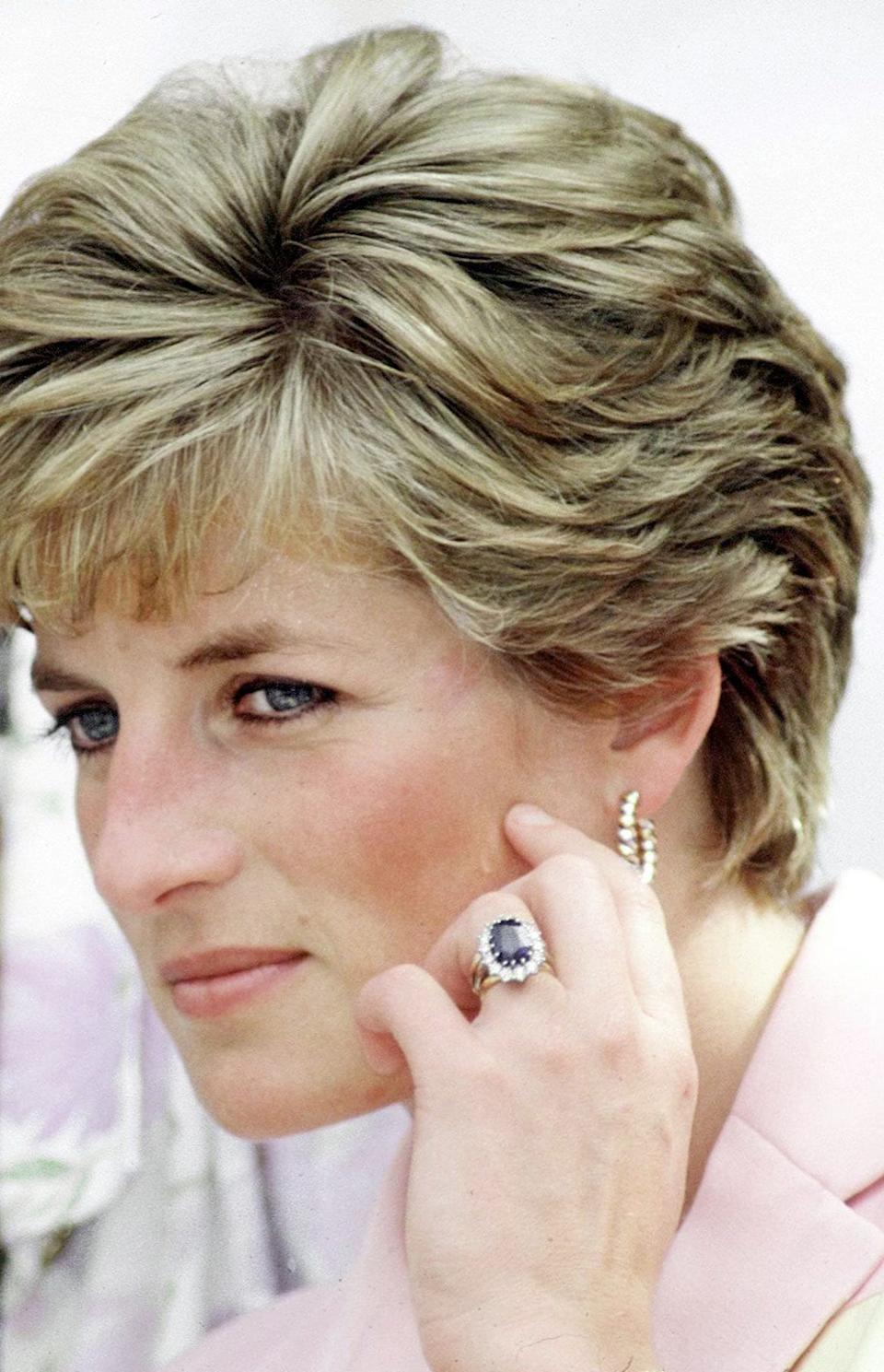 Princess Diana wearing her sapphire and diamond engagement ring - Tim Graham Photo Library via Getty Images