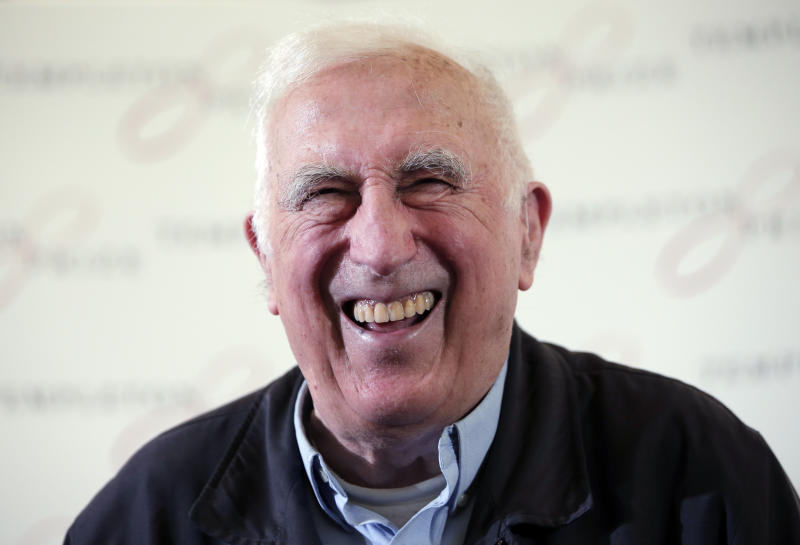 FILE - In this March 11, 2015 file photo, Jean Vanier, the founder of L'ARCHE, an international network of communities where people with and without intellectual disabilities live and work together, laughs during a news conference, in central London. Vanier, a Canadian religious figure whose charity work helped improve conditions for the developmentally disabled in multiple countries over the past half-century, has died Tuesday May 7, 2019 in Paris after suffering from thyroid cancer at 90. (AP Photo/Lefteris Pitarakis, File)