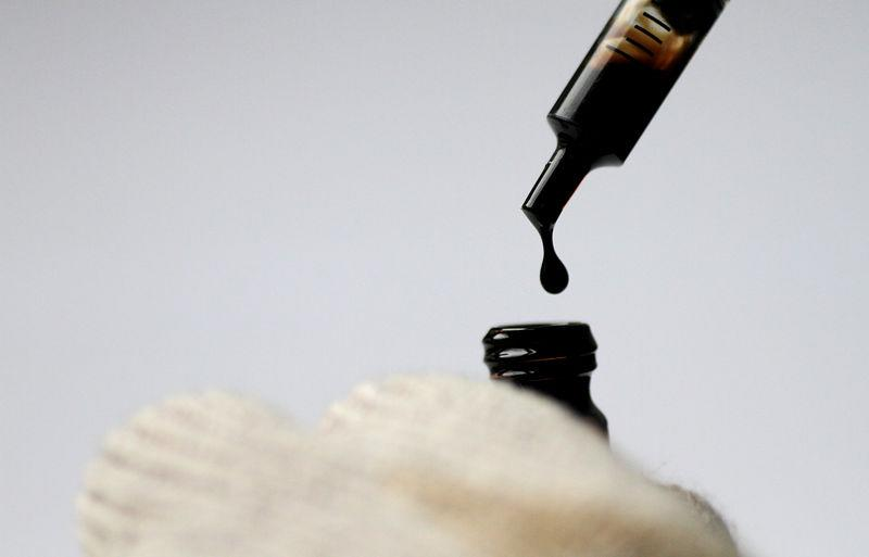 FILE PHOTO: Illustration photo of crude oil being dispensed into a bottle