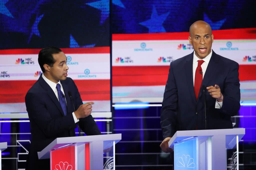 Former housing secretary Julian Castro and New Jersey Sen. Cory Booker during the first night of the Democratic presidential debate on June 26, 2019. | Joe Raedle—Getty Images