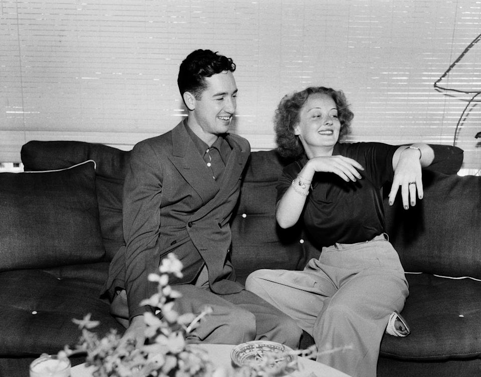 <p>Davis is pictured here with her first husband Harmon Oscar Nelson, Jr. in Los Angeles. The couple, who first met at boarding school in Massachusetts, were married in 1932 and divorced in 1938.</p>