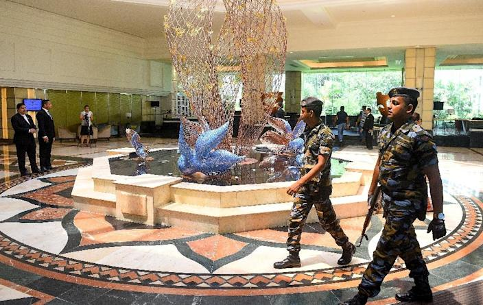 Armed soldiers outnumber guests at the re-opened Cinnamon Grand Hotel in Colombo (AFP Photo/ISHARA S. KODIKARA)