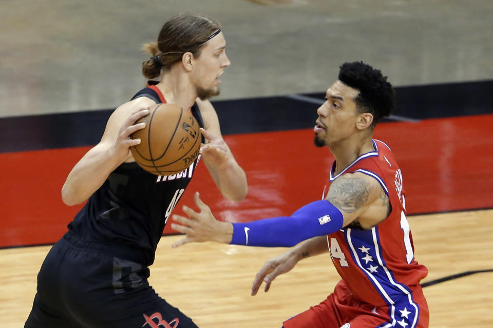 Houston Rockets forward Kelly Olynyk, left, looks to drive around Philadelphia 76ers forward Danny Green, right, during the first half of an NBA basketball game Wednesday, May 5, 2021, in Houston. (AP Photo/Michael Wyke, Pool)