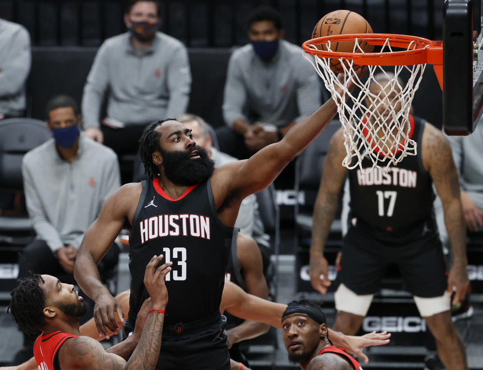 PORTLAND, OREGON - DECEMBER 26: James Harden #13 of the Houston Rockets shoots against the Portland Trail Blazers during the first quarter at Moda Center on December 26, 2020 in Portland, Oregon. NOTE TO USER: User expressly acknowledges and agrees that, by downloading and/or using this photograph, user is consenting to the terms and conditions of the Getty Images License Agreement. (Photo by Steph Chambers/Getty Images)