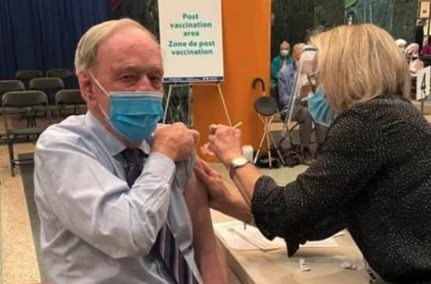 Former prime minister Jean Chrétien getting his first COVID-19 vaccine shot at city hall in Ottawa in March 2021.