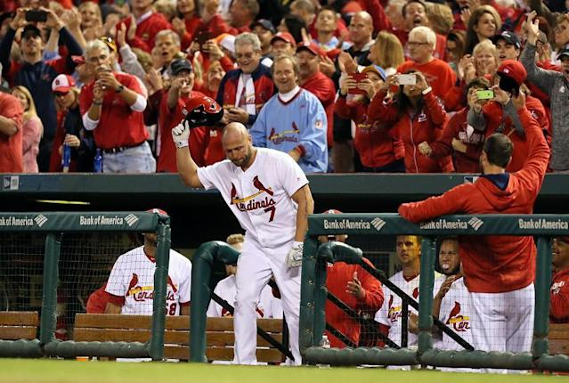 Cardinals' outfielder Matt Holliday obliges the fans with a curtain call after hitting a pinch-hit home run during a 7-0 with against the Pirates. (AP)