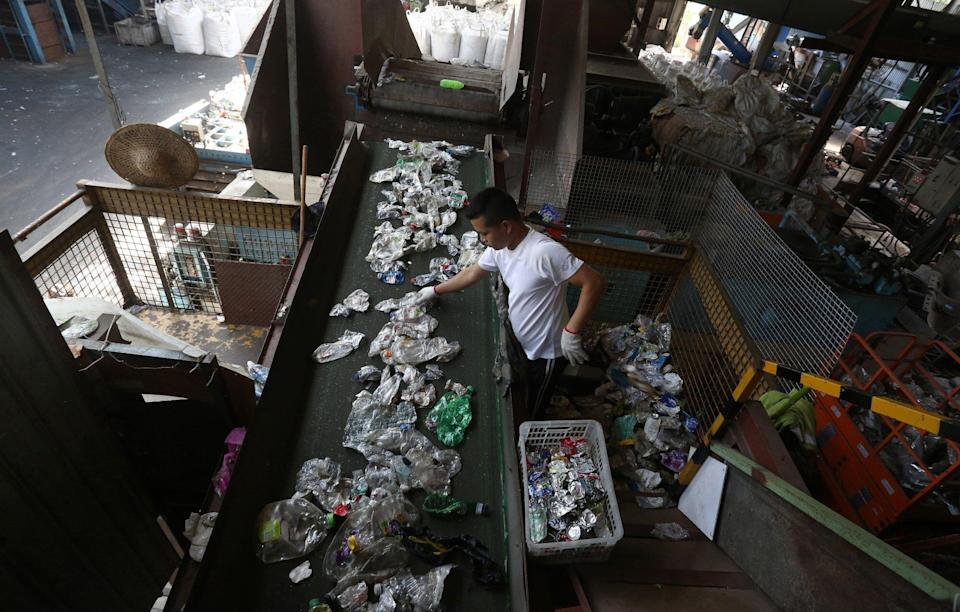 Staff sorting through collected scrap plastic at Allan Wong Wing-ho's recycling factory in Lung Kwu Tan, Hong Kong. Photo: Jonathan Wong