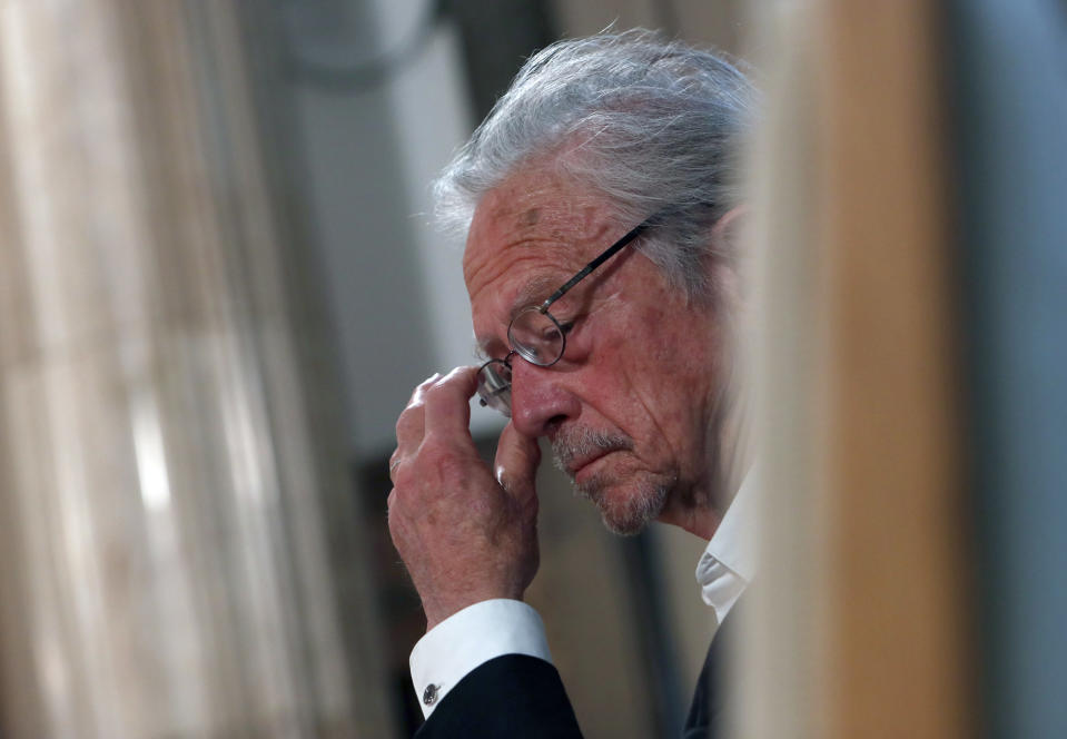 Austrian author Peter Handke attends a ceremony before receives the Order of the Karadjordje's Star from Serbian President Aleksandar Vucic in Belgrade, Serbia, Sunday, May 9, 2021. Serbia has decorated Austrian Nobel literature laureate Peter Handke, who is known for his apologist views over Serb war crimes during the 1990s' wars in the Balkans. (AP Photo/Darko Vojinovic)