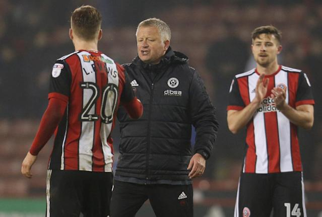 "Soccer Football - Championship - Sheffield United vs Middlesbrough - Bramall Lane, Sheffield, Britain - April 10, 2018 Sheffield United manager Chris Wilder celebrates with Lee Evans after the game Action Images/Ed Sykes EDITORIAL USE ONLY. No use with unauthorized audio, video, data, fixture lists, club/league logos or ""live"" services. Online in-match use limited to 75 images, no video emulation. No use in betting, games or single club/league/player publications. Please contact your account representative for further details."