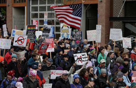 """People demonstrate during a """"March For Our Lives"""" demonstration demanding gun control in Seattle, Washington, U.S. March 24, 2018. REUTERS/Jason Redmond"""
