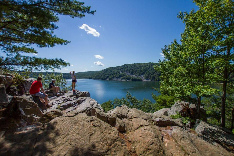 "<p>Open year-round, Baraboo's <a href=""https://www.tripadvisor.com/Attraction_Review-g59686-d116876-Reviews-Devil_s_Lake_State_Park-Baraboo_Wisconsin.html"" rel=""nofollow noopener"" target=""_blank"" data-ylk=""slk:Devil's Lake State Park"" class=""link rapid-noclick-resp"">Devil's Lake State Park</a> encircles a placid pool of water while hikers amble up rock-strewn paths that lead to jaw-dropping views.</p><p> <a class=""link rapid-noclick-resp"" href=""https://go.redirectingat.com?id=74968X1596630&url=https%3A%2F%2Fwww.tripadvisor.com%2FAttraction_Review-g59686-d116876-Reviews-Devil_s_Lake_State_Park-Baraboo_Wisconsin.html&sref=https%3A%2F%2Fwww.redbookmag.com%2Flife%2Fg34357299%2Fbest-hikes-in-the-us%2F"" rel=""nofollow noopener"" target=""_blank"" data-ylk=""slk:PLAN YOUR HIKE"">PLAN YOUR HIKE</a></p>"