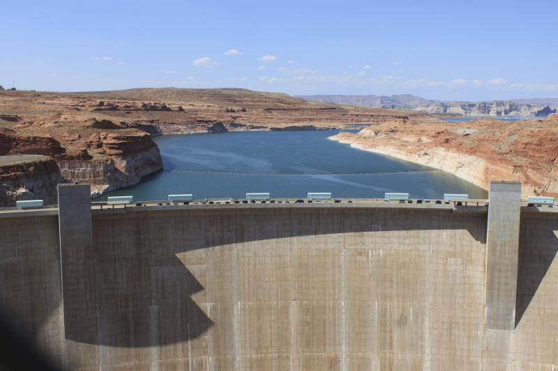 This Aug. 21, 2019 image shows Glen Canyon Dam in Page, Arizona. Environmental groups that have long pushed to bring down the dam along the Colorado River filed a lawsuit Tuesday, Oct. 2, 2019. They allege the U.S. Bureau of Reclamation ignored climate science when approving a 20-year operating plan for the dam. (AP Photo/Susan Montoya Bryan)