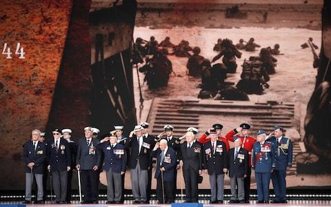 <span>D-Day veterans, front row, stand on stage</span> <span>Credit: AP </span>