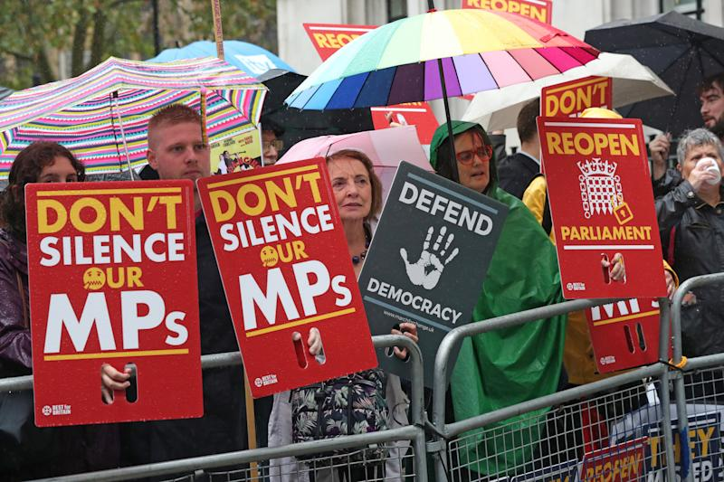 Protesters stand outside the Supreme Court, where judges judges that Boris Johnson broke the law when he decided to suspend Parliament.