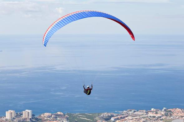 Competitors flying above the coast at the  Open International Parascending Competition in Adeje, Tenerife, Canary Islands. 6th t