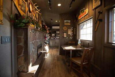 """The 269 sq-ft. """"Tiny Home Away from Home"""" replicates the unique experience of visiting a Cracker Barrel store, and blends together some of the most unique and beloved elements of a real store, including the iconic front porch, a replica of the cozy fireplace and a miniature retail store."""
