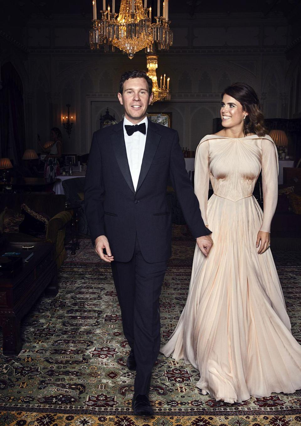 "<p>The second dress Princess Eugenie wore to her royal wedding in October 2018 is one for the books. For her reception, the Princess changed into a<a href=""https://www.townandcountrymag.com/style/fashion-trends/a23697214/princess-eugenie-second-royal-wedding-reception-zac-posen-dress-photos/"" rel=""nofollow noopener"" target=""_blank"" data-ylk=""slk:blush tone draped gown"" class=""link rapid-noclick-resp""> blush tone draped gown</a> designed by Zac Posen.</p>"
