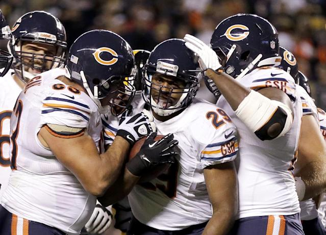 Chicago Bears running back Michael Bush (29) celebrates scoring a touchdown with teammates in the first quarter of an NFL football game against the Pittsburgh Steelers in Pittsburgh, Sunday, Sept. 22, 2013. (AP Photo/Gene J. Puskar)