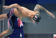 Caeleb Dressel of the United States starts in the men's 100-meter freestyle final at the 2020 Summer Olympics, Thursday, July 29, 2021, in Tokyo, Japan. (AP Photo/Matthias Schrader)