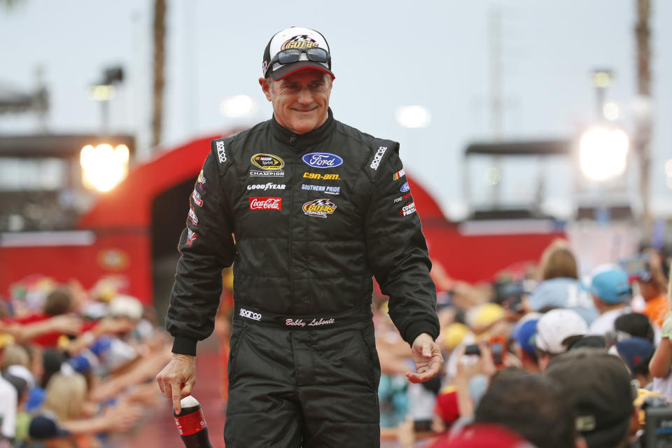 FILE - Bobby Labonte is greeted by fans during driver introductions before the start of the NASCAR Sprint Cup auto race at Daytona International Speedway in Daytona Beach, Fla., in this Saturday, July 2, 2016, file photo. Superstar Racing Experience (SRX) will be a completely new experience for most of the 12-driver field, which at Stafford Speedway in Connecticut will feature NASCAR Hall of Famer's Stewart, Bill Elliott and Bobby Labonte, as well as Greg Biffle, Michael Waltrip, Willy T. Ribbs, and Indianapolis 500 winner Tony Kanaan, Paul Tracy and Marco Andretti, as well as Ernie Francis Jr., an accomplished road racer who at 23 is the youngest driver in the field. (AP Photo/Wilfredo Lee, File)