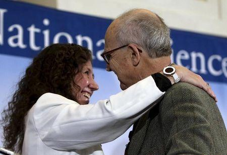 Dr. Gabriela Gonzalez, spokesperson for the LIGO Scientific Collaboration (L) embraces Dr. Rainer Weiss (R) of MIT at a news conference to discuss the detection of gravitational waves, ripples in space and time hypothesized by physicist Albert Einstein a century ago, in Washington February 11, 2016. REUTERS/Gary Cameron