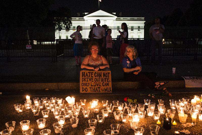 People gather in front of the White House on August 13, 2017, for a vigil in response to the death of a counter-protester during a racist rally in Charlottesville, Virginia