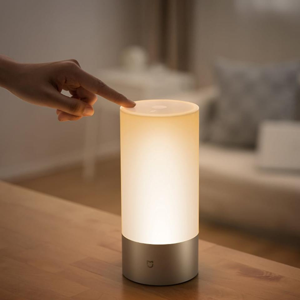 """<p>Achieve a good night's sleep with this helpful <a href=""""https://www.popsugar.com/buy/Xiaomi-Mi-Smart-Bedside-Lamp-408635?p_name=Xiaomi%20Mi%20Smart%20Bedside%20Lamp&retailer=walmart.com&pid=408635&price=45&evar1=savvy%3Aus&evar9=46284382&evar98=https%3A%2F%2Fwww.popsugar.com%2Fsmart-living%2Fphoto-gallery%2F46284382%2Fimage%2F46284404%2FXiaomi-Mi-Smart-Bedside-Lamp&list1=shopping%2Cwalmart%2Cunder%20%2450&prop13=mobile&pdata=1"""" rel=""""nofollow"""" data-shoppable-link=""""1"""" target=""""_blank"""" class=""""ga-track"""" data-ga-category=""""Related"""" data-ga-label=""""https://www.walmart.com/ip/Xiaomi-Mi-Smart-Bedside-Lamp-10W-Color-LED/440717294"""" data-ga-action=""""In-Line Links"""">Xiaomi Mi Smart Bedside Lamp</a> ($45). It comes with 16 million color customizations (yes, really) so you can find your perfect configuration.</p>"""