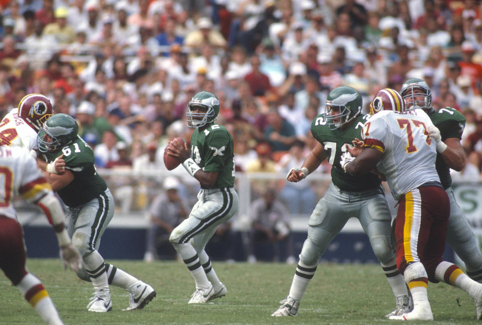 Randall Cunningham of the Philadelphia Eagles drops back to pass on September 17, 1989, at RFK Stadium in Washington D.C. (Focus on Sport/Getty Images)