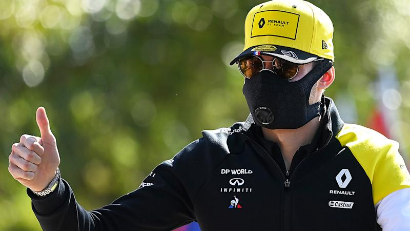 Renault F1 driver Esteban Ocon is pictured arriving at the Australian GP wearing a facemask.