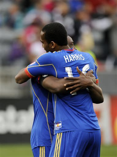 Colorado Rapids forward Atiba Harris, right, of St. Kitts, hugs Rapids midfielder Hendry Thomas, left, of Honduras, after Harris scored in the first half of an MLS soccer game against Real Salt Lake in Commerce City, Colo., on Saturday, April 6, 2013. (AP Photo/Chris Schneider)