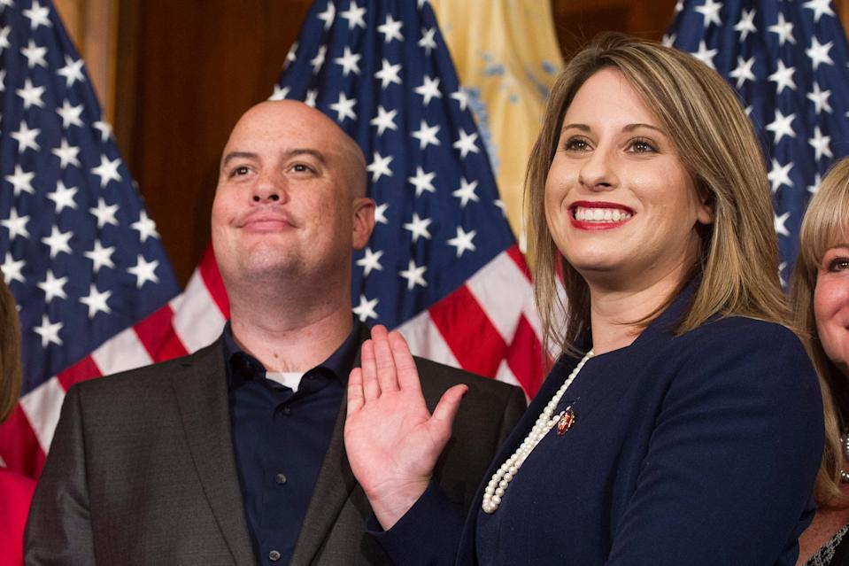 <p>Rep. Katie Hill, D-Calif., and Hill's ex-husband, Kenneth Heslep, pose during a ceremonial swearing in on Capitol Hill in Washington during the opening session of the 116th Congress. </p> ((AP Photo/Cliff Owen, File))