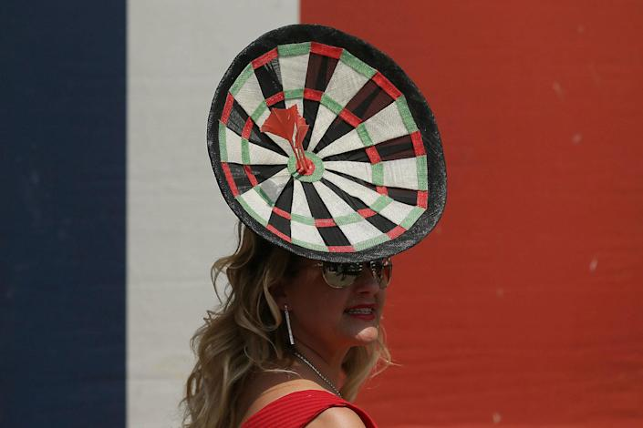 <p>A racegoer poses for photographers on the second day of the Royal Ascot horse race meeting in Ascot, England, Wednesday, June 21, 2017. (AP Photo/Tim Ireland) </p>