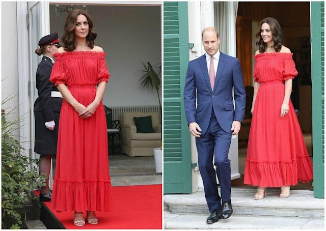 Kate looked elegant in a cherry-red, off-the-shoulder Alexander McQueen maxi dress for a garden party at the British ambassador's home in Berlin. <em>(Photos: Getty)</em>