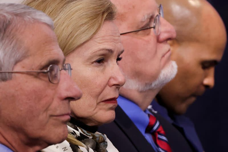 FILE PHOTO: White House coronavirus task force members Fauci, Birx, Redfield and Adams listen to Trump during the daily coronavirus briefing at the White House in Washington