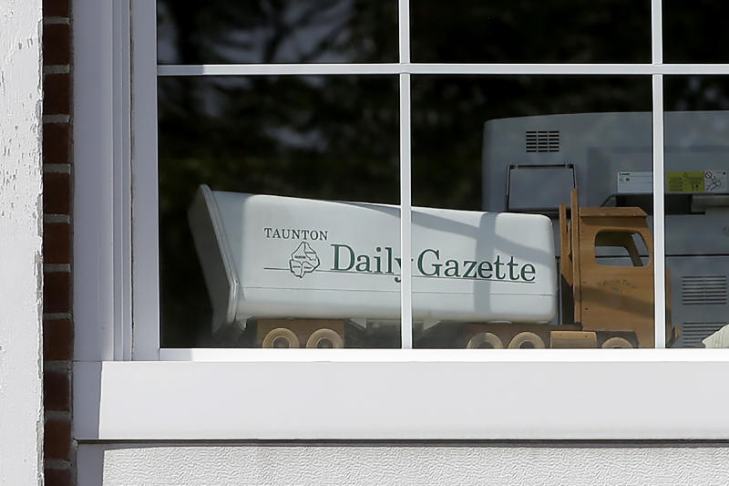In this Monday, Aug. 5, 2019 photo a model truck sits in a window of the Taunton Daily Gazette newspaper's offices, in Taunton, Mass. The newspaper is published by GateHouse Media New England, a division of GateHouse Media Inc. On Monday, GateHouse Media, a chain backed by an investment firm, announced that it is buying USA Today owner Gannett Co. (AP Photo/Steven Senne)