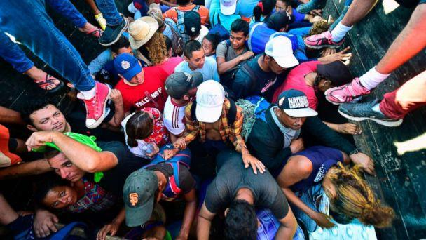 PHOTO: Honduran migrants taking part in a caravan heading to the US, aboard a truck in Metapa on their way to Tapachula, Chiapas state, Mexico on Oct. 22, 2018. (Pedro Pardo/AFP/Getty Images)