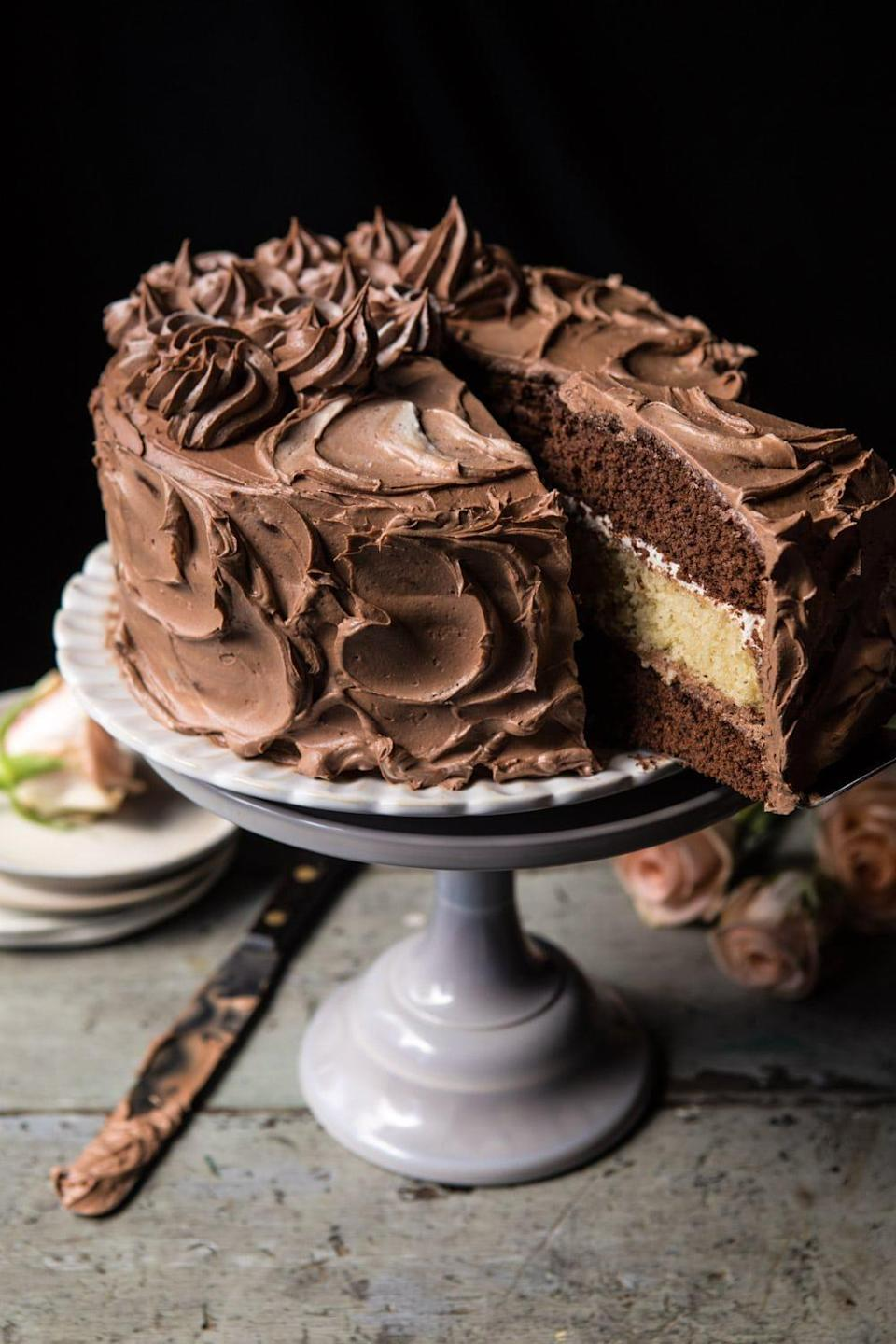 "<p>Get the best of both worlds when you make this delicious cake. You'll get forkfuls of vanilla cake that's sandwiched between two layers of chocolate cake and topped with both chocolate and vanilla buttercream. Need we say more?</p> <p><strong>Get the recipe</strong>: <a href=""https://www.halfbakedharvest.com/chocolate-vanilla-birthday-cake/"" class=""link rapid-noclick-resp"" rel=""nofollow noopener"" target=""_blank"" data-ylk=""slk:better together chocolate vanilla cake"">better together chocolate vanilla cake</a></p>"