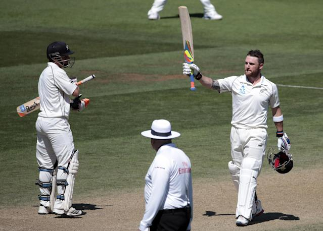 New Zealand's Brendon McCullum (R) acknowledges his 200 against India during the second innings on day four of the second international test cricket match at the Basin Reserve in Wellington, February 17, 2014. REUTERS/Anthony Phelps (NEW ZEALAND - Tags: SPORT CRICKET TPX IMAGES OF THE DAY)