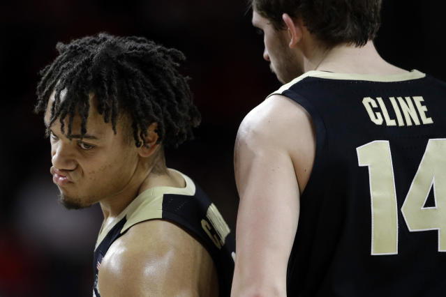 Purdue guard Carsen Edwards, left, reacts in front of teammate Ryan Cline in the final moments of the team's NCAA college basketball game against Maryland, Tuesday, Feb. 12, 2019, in College Park, Md. Maryland won 70-56. (AP Photo/Patrick Semansky)