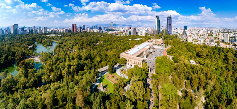Panoramic aerial view of Chapultepec Castle with Mexico City skyline on the background