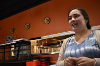 Yolanda Rojas talks in Los Saguaros, the restaurant she owns with her husband, Aug. 26, 2021, in Watford City, N.D. The couple saved enough money to open the restaurant in March 2020 — just as the pandemic arrived. The business was teetering on failure when Rojas reached out to the community on social media. People in Watford City rallied to help, regularly ordering takeout to keep the family afloat. (AP Photo/Matthew Brown)