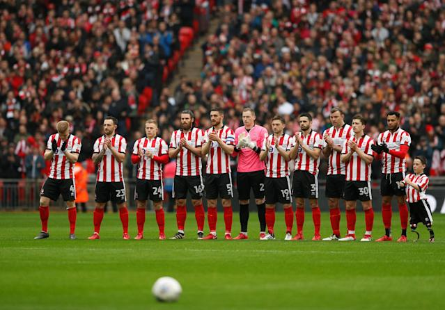 "Soccer Football - Checkatrade Trophy Final - Lincoln City vs Shrewsbury Town - Wembley Stadium, London, Britain - April 8, 2018 Lincoln City players during a minute's applause in memory of Ray Wilkins before the match Action Images/Andrew Boyers EDITORIAL USE ONLY. No use with unauthorized audio, video, data, fixture lists, club/league logos or ""live"" services. Online in-match use limited to 75 images, no video emulation. No use in betting, games or single club/league/player publications. Please contact your account representative for further details."